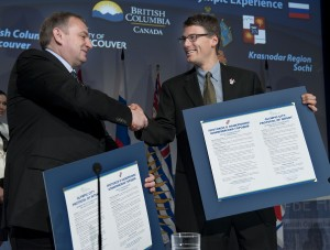 Mayor of Sochi, Anatoli N. Pakhomov, and Mayor of Vancouver, Gregor Robertson shake hands after signing the protocol of intent at Robson Square.