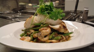 Oyster Mushroom and fresh organic green beans harm salad  with Grilled halibut by Chef Honoré Gbedze