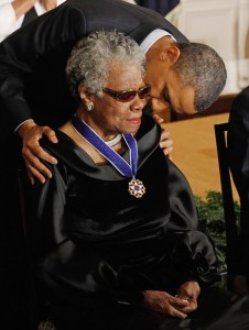 President Obama kisses Poet and Author Maya Angelou after giving her the 2010 Medal of Freedom in the East Room of the White House February 15, 2011 in Washington, DC.