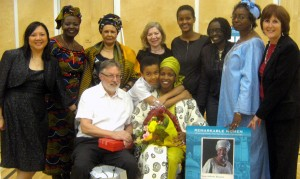 Jane Rukaria with husband Patrick O'Reilly and son Killian Mwenda (seated) and friends at the at the City of Vancouver Parks Board Remarkable Women 2011 Awards celebration. (Standing L to R:Selina Chan, Jennifer Khayang, Njambi Woods, Lilliana Chuaqui, daughter Fauziya Issa, Julianne Okot Bitek, Maika Tshimbalanga, Judy Lynch)